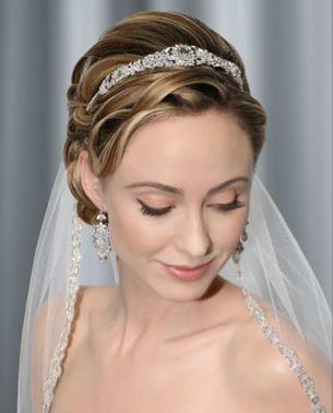 Traditional wedding updo with tiara